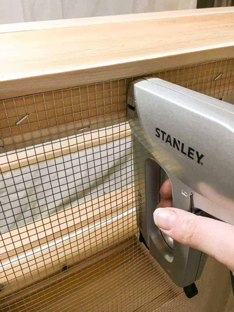 Add wire mesh to the bottom of your DIY storage bench to allow water and dirt to pass through.