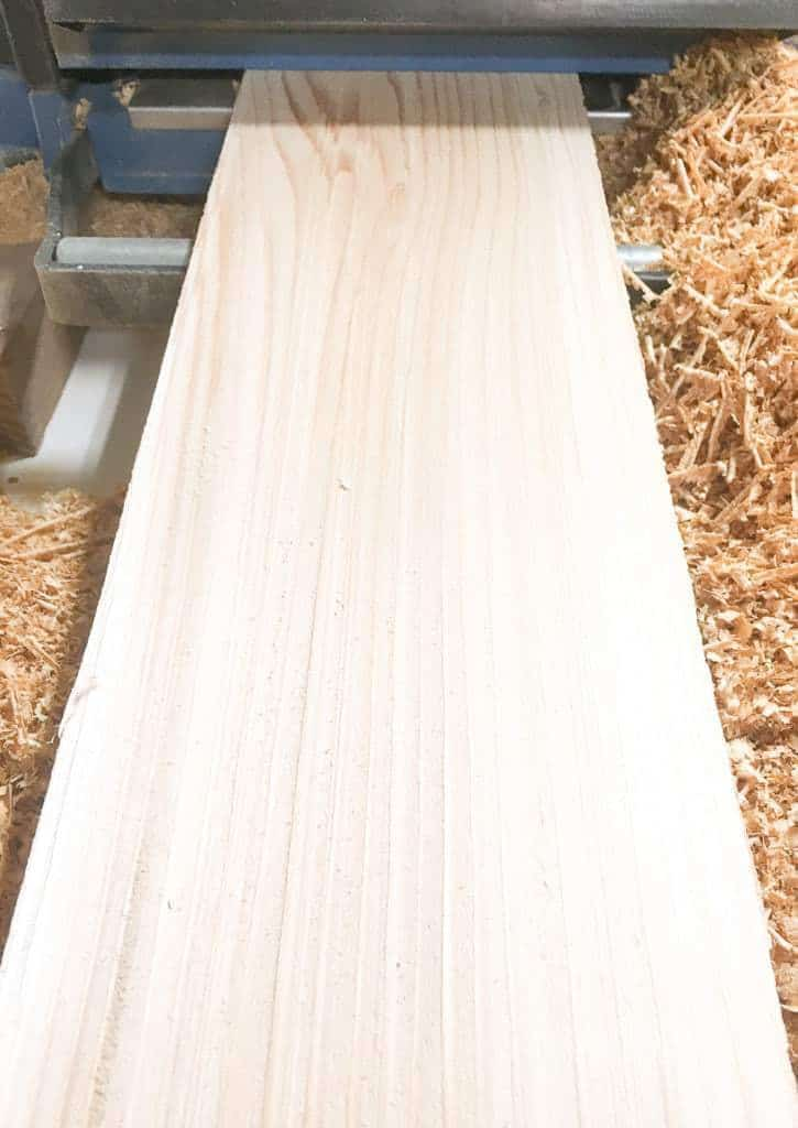 A thickness planer makes a huge mess, but it transforms cheap cedar fence pickets into freshly milled planks!