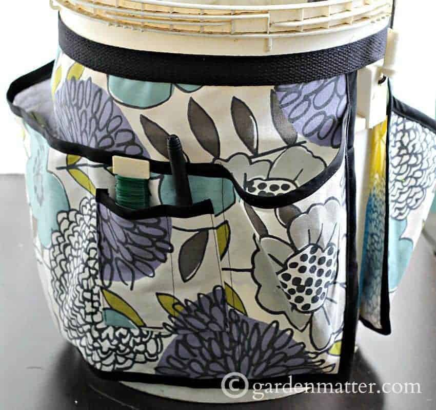 bucket with apron used as garden tool storage
