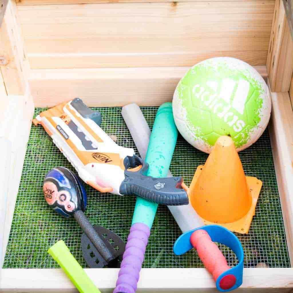 The interior of this DIY storage bench is huge, and will be able to store plenty of outdoor toys.