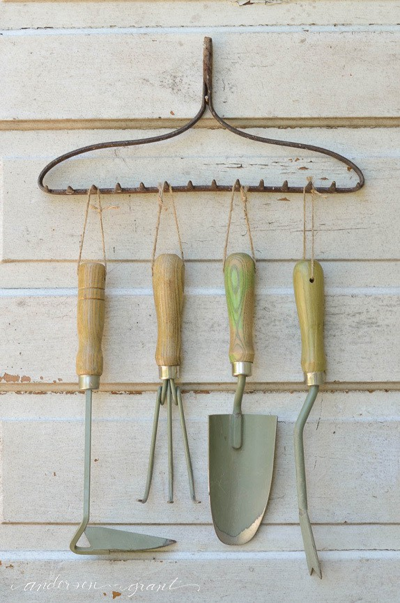 rake used as garden tool storage