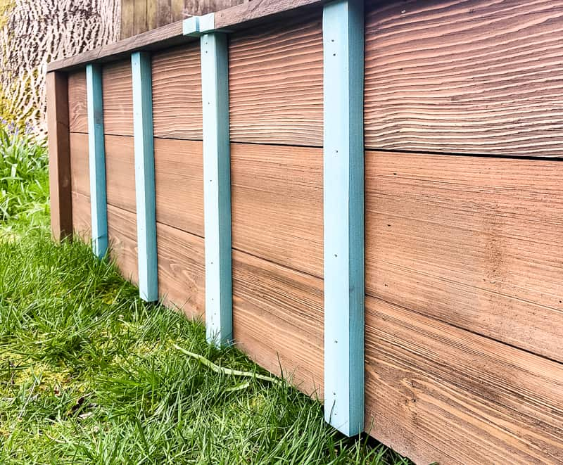 decorative slats on the front of the outdoor storage bench