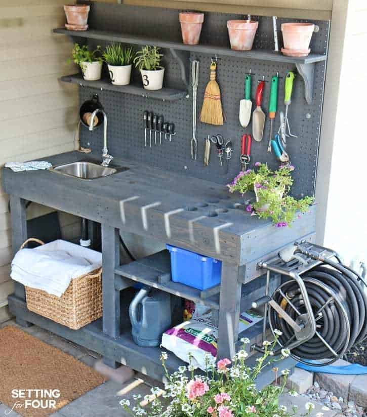 potting bench with hanging garden tool storage