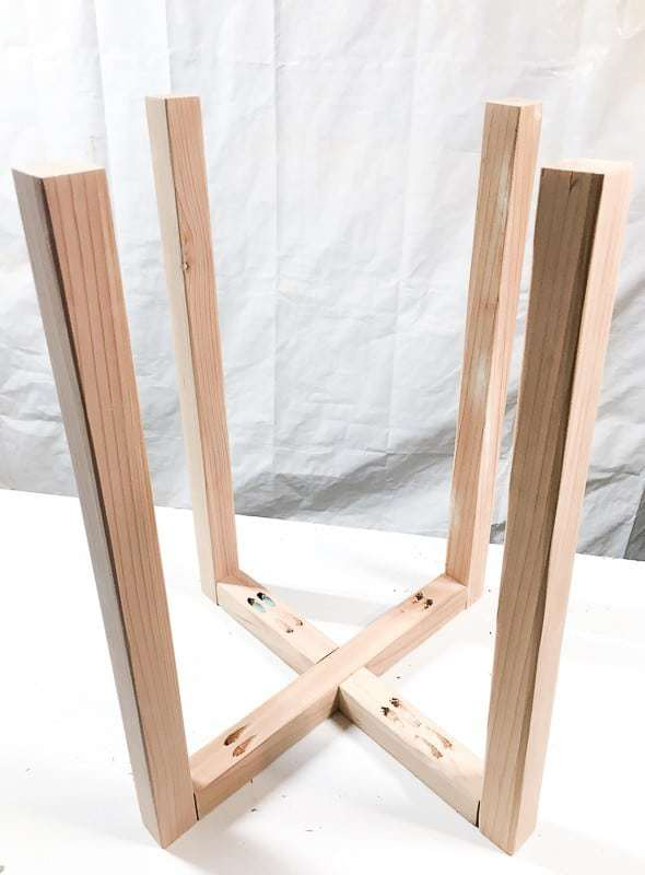 Attach legs to the X base of the hexagon side table.