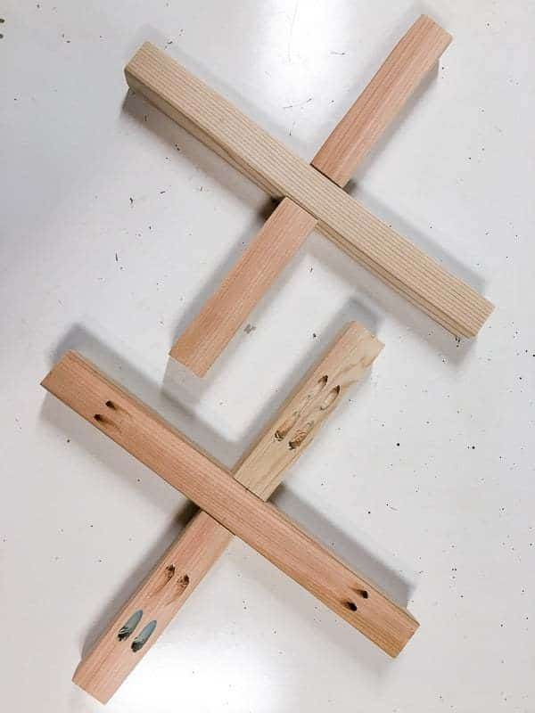 Assemble the X pieces for the base of the hexagon side table with pocket hole screws.