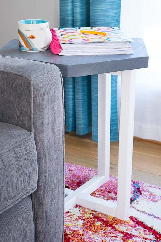 This DIY hexagon side table fits perfectly in our living room, and gives me a spot for my planner and an endless supply of coffee! Get the free plans to build it yourself! | Free woodworking plans | side table idea | DIY side table | hexagon table