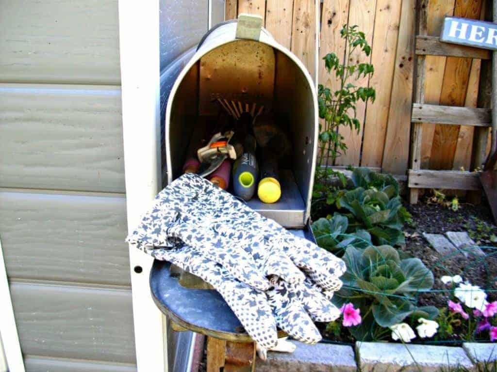 mailbox used as garden tool storage