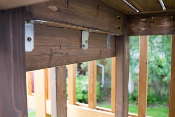 Use brackets to attach the two sides of your end table together.