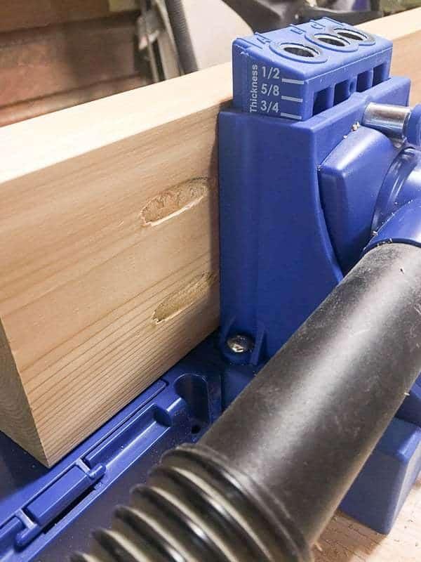 drilling pocket holes along length of board