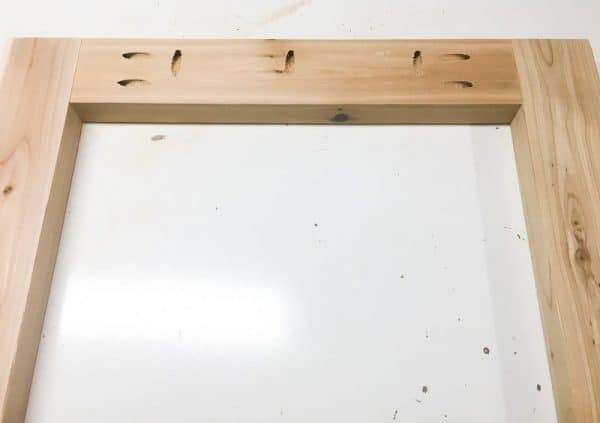 "Attach the legs of the DIY end table together with 2 1/2"" pocket hole screws."
