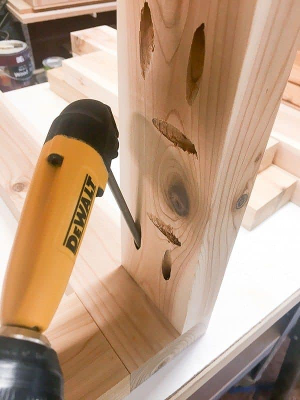 If you can't fit your drill inside the frame to screw it into place, a right angle attachment makes it easy!
