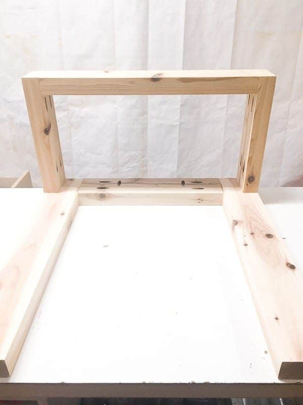 Assemble the planter side of the DIY end table the same way, but without one set of legs.