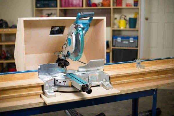 This miter saw dust hood is perfect for containing sawdust in your workshop.