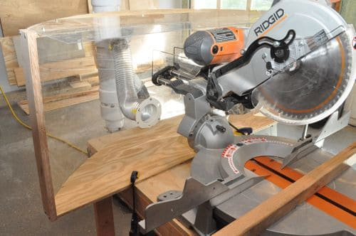 This plexiglass miter saw dust collector lets the light shine through to your work.