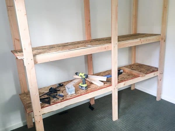 second shelf of shed shelving unit being assembled