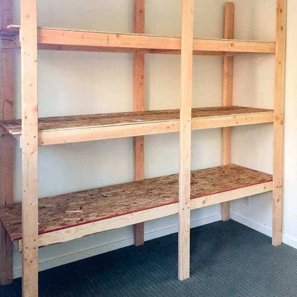 simple shed shelving built from 2x4s and OSB