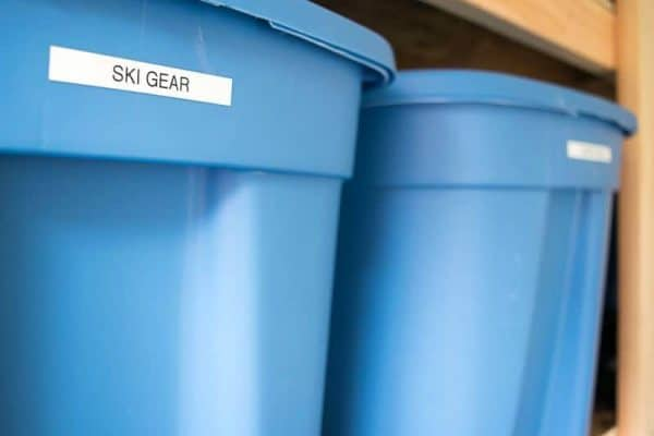 large plastic bins on shed shelving