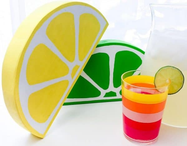 These giant lemon and lime slices are the perfect decor for a drink stand!