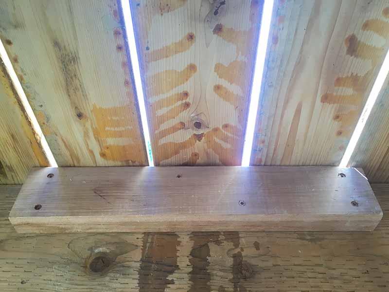 2X4 screwed in under warped board