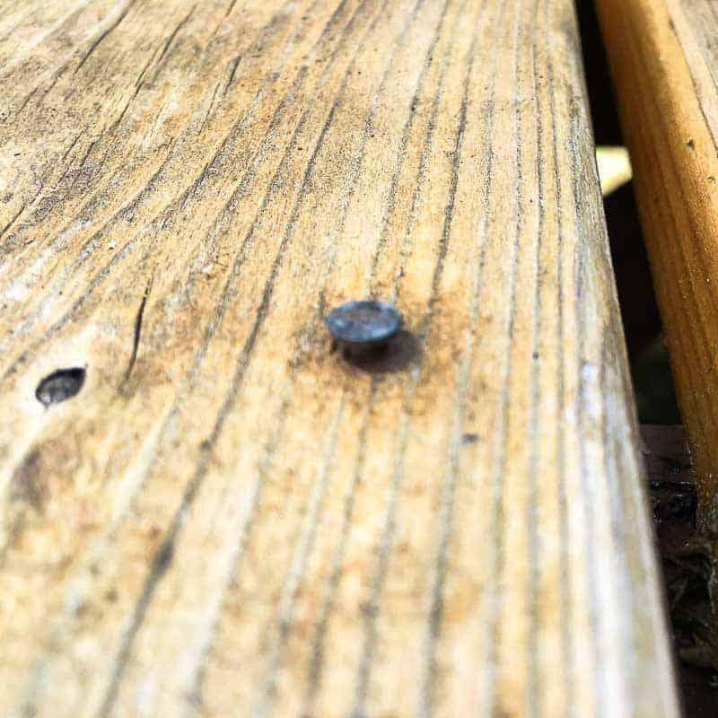 popped nail in cedar deck board   deck repair tasks