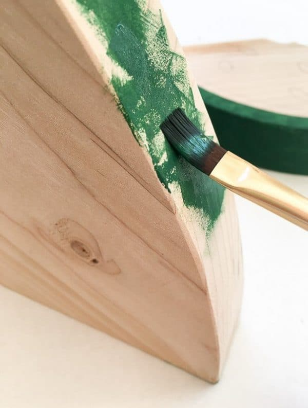Paint the rind of the watermelon decor with short strokes that let some of the wood color show through.