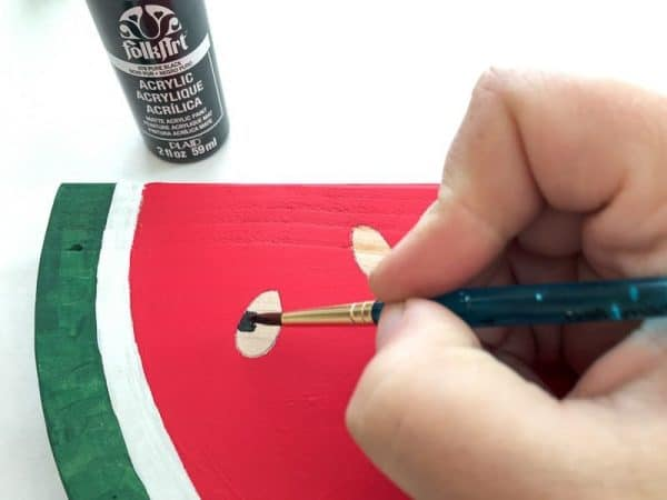 Paint the seeds onto your watermelon decor with a small craft brush.