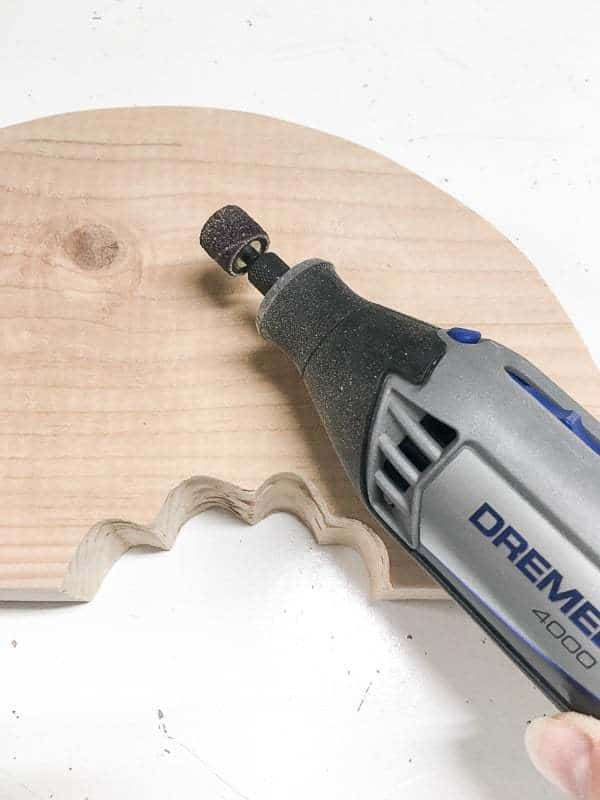 Use a Dremel with a sanding drum attachment to get into the bite marks of your watermelon decor.