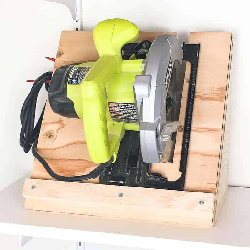 Tired of your circular saw sitting in a jumbled mess? This simple circular saw storage rack keeps it neatly stowed away until your next project inspiration strikes! | workshop storage | garage storage | easy woodworking project | tool storage