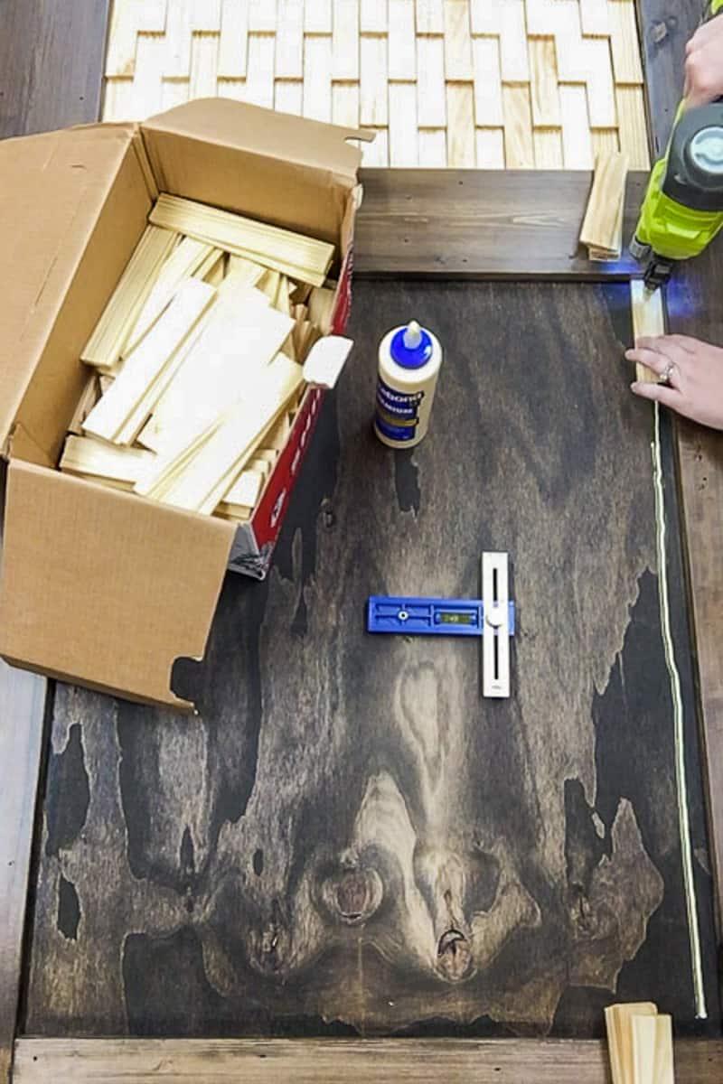 attaching first wood shim on DIY barn door