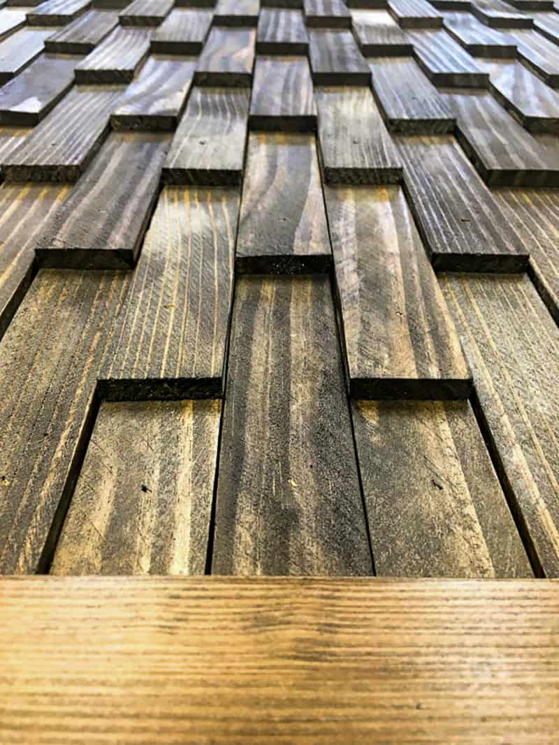layered wood shims stained dark brown on DIY barn door