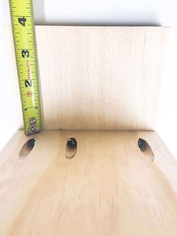 "Attach the second shelf 3 3/4"" from the bottom of the desktop organizer."