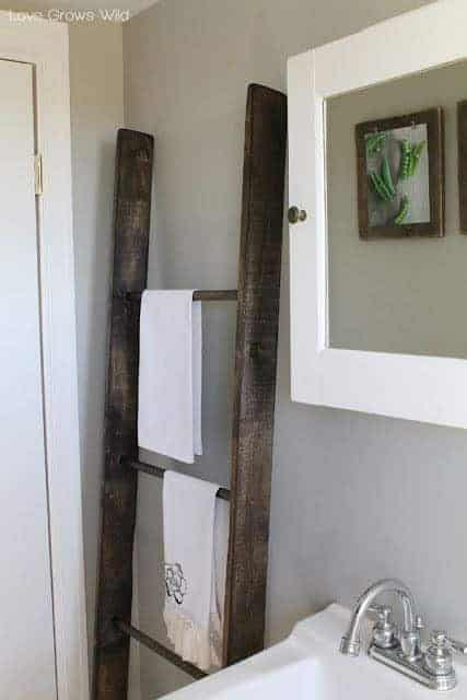 If your ladder has seen better days, give it new life as a towel rack instead!