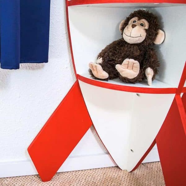 We have a monkey stowaway on our rocket bookshelf!