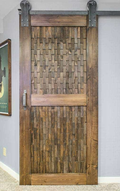 The wood shim texture on this sliding barn door is just amazing!