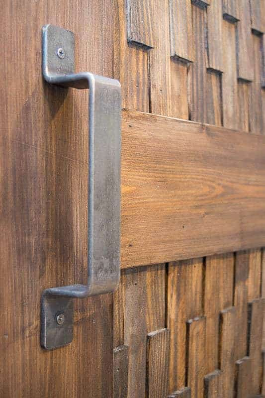 The patina on this sliding barn door hardware makes it look like it's been in use forever!