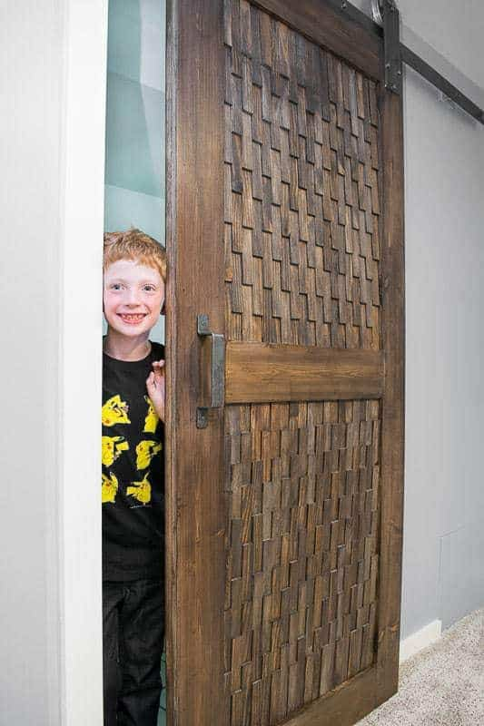Our son loves trying out our new sliding barn door hardware!