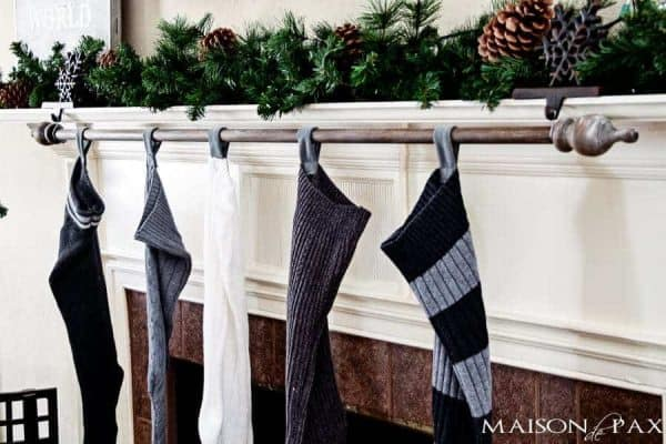 There's plenty of room for everyone with this stocking holder made from a curtain rod!