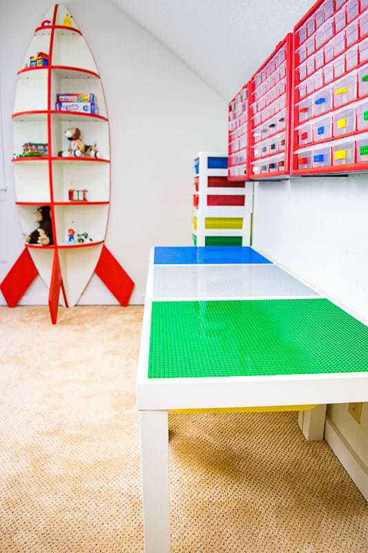 DIY lego table with wall mounted storage and rocket ship bookshelf