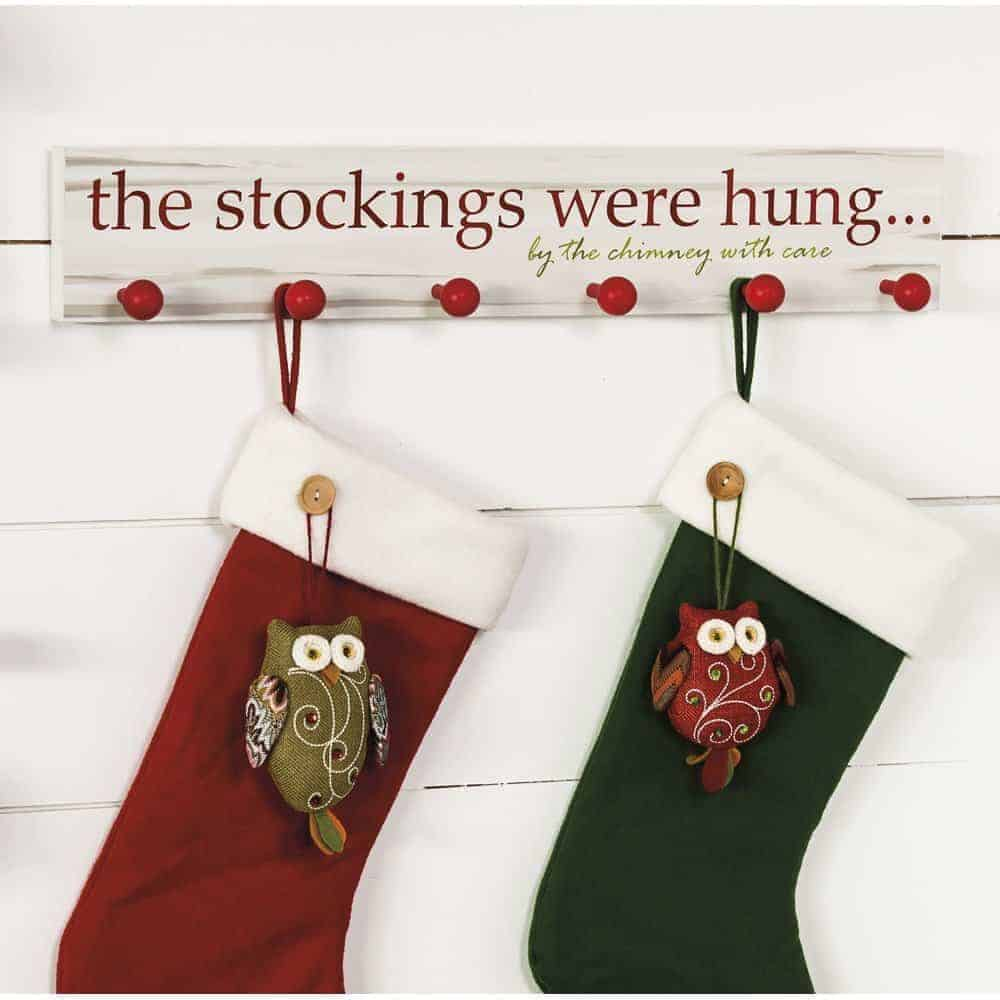 """wall mount stocking holder with """"The stockings were hung by the chimney with care"""" written on it"""
