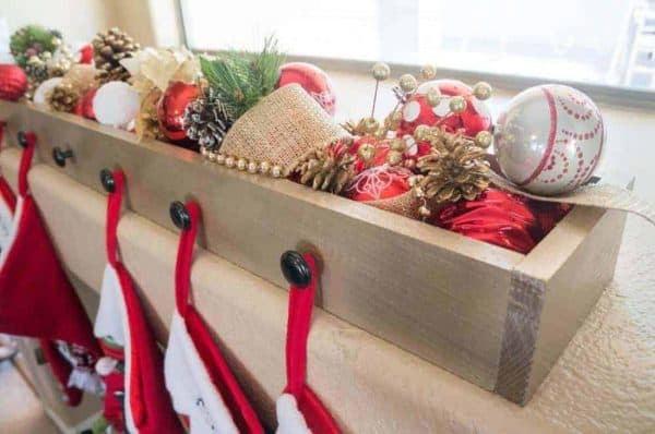 Hang stockings from the windowsill with this decorative box with stocking holders from A Mom's Take!