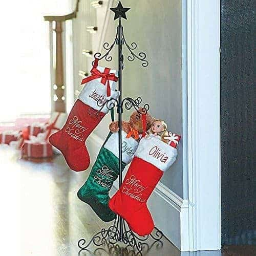 This metal stocking holder stand can go anywhere, not just by the fireplace!