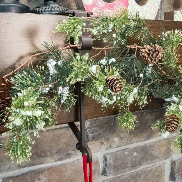 Running out of room on your mantel? These genius stocking holders have additional hooks for your garland!
