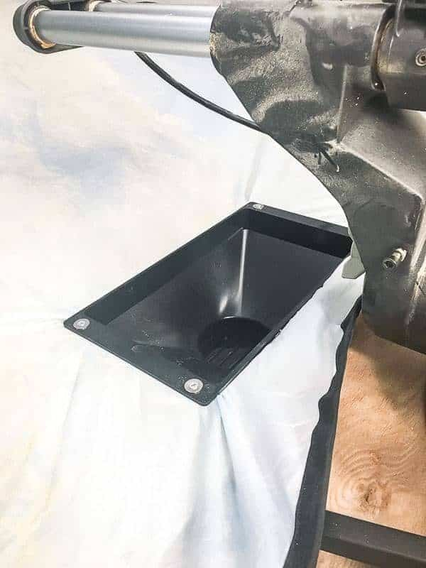 Attach the dust funnel to the bottom of the miter saw dust hood.