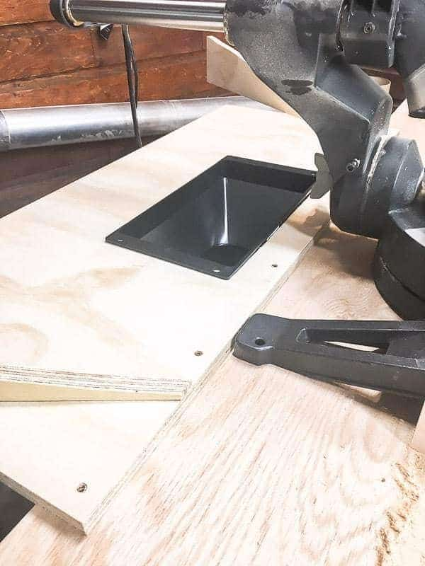 Attach the platform to the back of your miter saw stand.