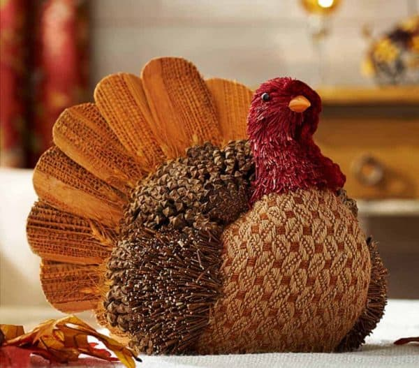 I love the contrast of hard and soft in this turkey decoration! Soft quilted fabric mixed with rough pine cones and twigs gives this little guy a unique look.