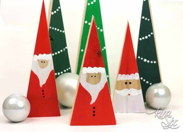 The 4th day of a DIY Christmas comes from The Kim Six Fix with these adorable Santas and Christmas trees out of 2 x 4's!