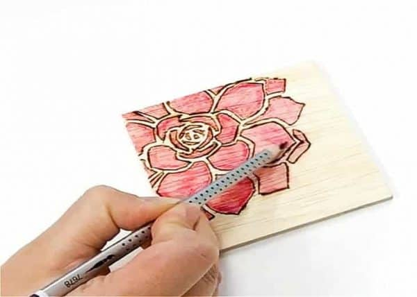 Color in your design on your wooden coasters with watercolor pencils.