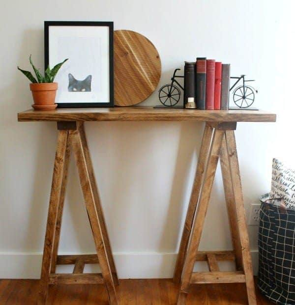 Love the unique look of this sawhorse console table from Woodshop Diaries!