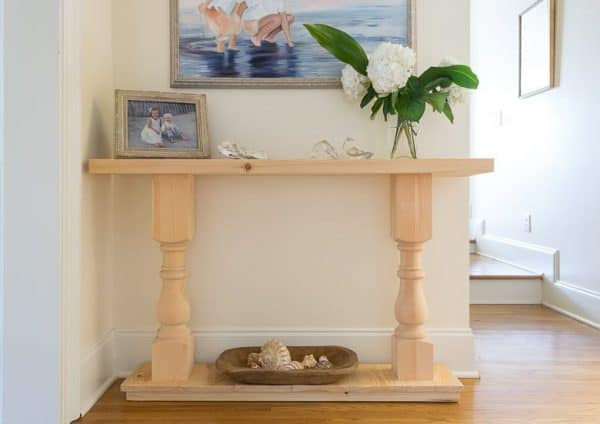 Combine pre-made legs with a DIY top and bottom to create this console table from Nourish and Nestle!