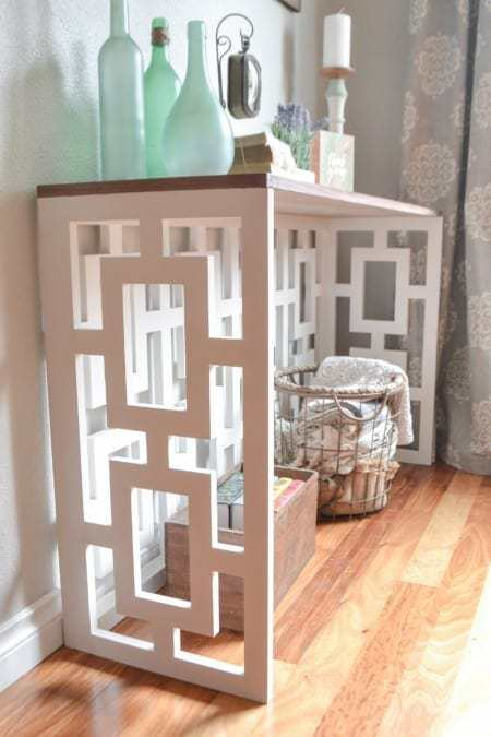 This amazing fretwork console table looks like it cost a fortune, but it's a DIY!